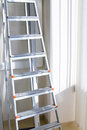 Ladder in the office Stock Images