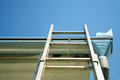 Ladder on the roof new shiny ladders Royalty Free Stock Photos