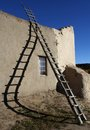 Ladder and shadow at san lorenzo church picuris pueblo nm casting twisted on external wall of an adobe style structure the indian Stock Photos