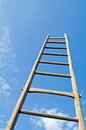 Ladder in sky frog perspective shot of old wooden Stock Photo