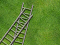Ladders on grass Stock Photo
