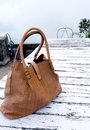 Ladies big handbag on the table old wooden Stock Image