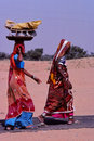 Ladies carrying baskets jaisalmer india still today so many villages and people in rajasthan have no proper water supply and and Royalty Free Stock Photography