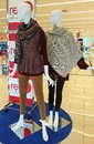 Ladies fashions two mannequins with fall sweaters and tights a scarf is added for beautiful color Stock Images
