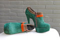 Ladies the green suede shoes on a heel and platform Stock Photography