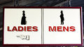 Ladies and Mens restrooms sign