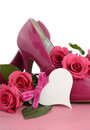 Ladies pink high heel stiletto shoes and roses international womens day march on vintage wood background vertical Stock Image