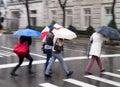 Ladies with umbrellas in the rain Stock Photo