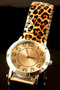 Ladies watch with print strap closeup of luxurious animal black background Stock Photography