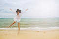 Lady on the beach beautiful asian wearing white shirt walking Stock Images