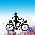 Lady on bicycle in grass Stock Photos