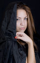 Lady in a black cape dramatic portrait of young may be young witch Royalty Free Stock Photography