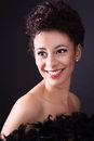 Lady in black multi ethnic smiling Stock Images