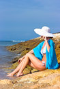 Lady in blue shawl on the beach Royalty Free Stock Photo