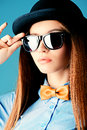 Lady in bow tie elegant girl model poses blouse and bowler hat refined style of old europe Royalty Free Stock Photos