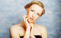 Lady with a braid on sky backround Royalty Free Stock Photo