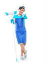 Lady with broom happy cleaning holding a and making a thumbs up isolated in white background full body picture Royalty Free Stock Photos