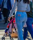Lady with cell phone in back pocket Royalty Free Stock Photo