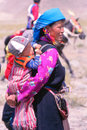 Lady with child at festival in ladakh india till date the people of are semi nomads and take their yak sheep and goats to the high Royalty Free Stock Photos