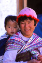 Lady with child at festival in ladakh india till date the people of are semi nomads and take their yak sheep and goats to the high Stock Photos