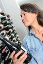 Lady choosing bottle wine Royalty Free Stock Photo