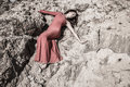 Lady in dress laying in the dirt Royalty Free Stock Photo