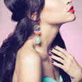 Lady with earring fashion studio portrait of beautiful young woman beauty and manicure jewelry and accessories Stock Image