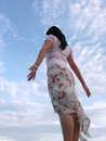 Lady feeling the wind with sky Royalty Free Stock Photo
