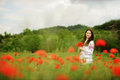 Lady in field of poppies Royalty Free Stock Photo