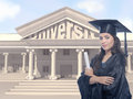 Lady graduate portrait of brunette in black gown and mortarboard holding graduation certificate Stock Images