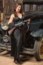 Lady with gun looking away beautiful woman vintage machine Royalty Free Stock Photos