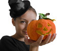 Lady with a halloween pumpkin young wearing hat in his hand Royalty Free Stock Image
