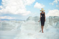 Lady in hat in an unusual landscape fashion photo of beautiful Royalty Free Stock Images