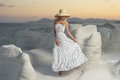 Lady in hat in an unusual landscape fashion photo of beautiful Stock Images