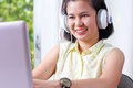 Lady with headset young asian listening to music on a Stock Photo