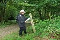 Lady Hiker reading a Map on a Footpath Royalty Free Stock Photos