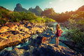 Lady hiker standing on the rock and enjoying view of river Royalty Free Stock Images