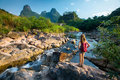 Lady hiker standing on the rock and enjoying view of river Royalty Free Stock Photography