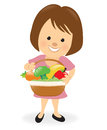 Lady holding fruit and veggie basket Royalty Free Stock Photo