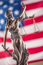 Lady Justice and American flag. Symbol of law and justice with U Royalty Free Stock Photo