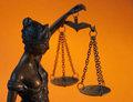 Lady justice temida themis the sculpture statue of on orange background Stock Photos
