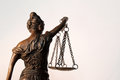 Lady justice temida themis the sculpture statue of on white background Stock Photo