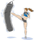 Lady kickboxer killing the bag Royalty Free Stock Photo