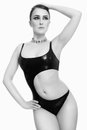 Lady in latex black and white shot of young beautiful sexy woman swimsuit over white background Royalty Free Stock Photos