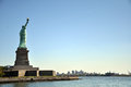Lady liberty island just in front of new jersey Royalty Free Stock Photo