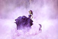 Lady in a luxury lush purple dress Royalty Free Stock Photo