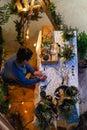 Lady makes flower arrangements in winter