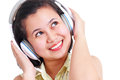 Lady and music close up of young listening on a headset Stock Images