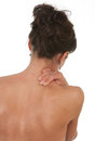 Lady neck shoulder pain shot against white background Royalty Free Stock Image