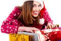 Lady opening christmas gifts Royalty Free Stock Photos
